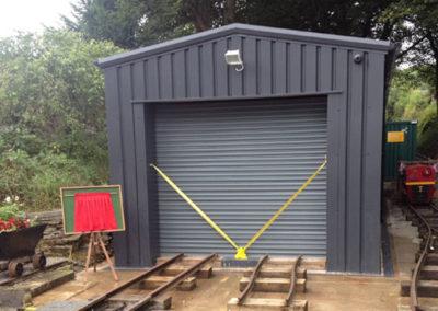 Storage building for miniture railway